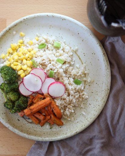 A stir fry with vegetables and sprouted brown rice