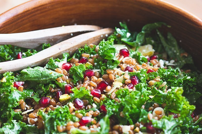 Assembling wheat berry salad ingredients in a large bowl