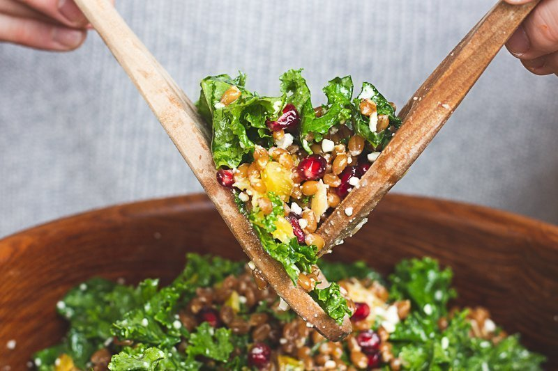 Serving sprouted wheat berry and kale salad from a large salad bowl